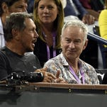 Oracle founder and tennis fanatic Larry Ellison, left, chats up John McEnroe and Bill Gates at Ellison's BNP Paribas Open in Indian Wells, Calif.
