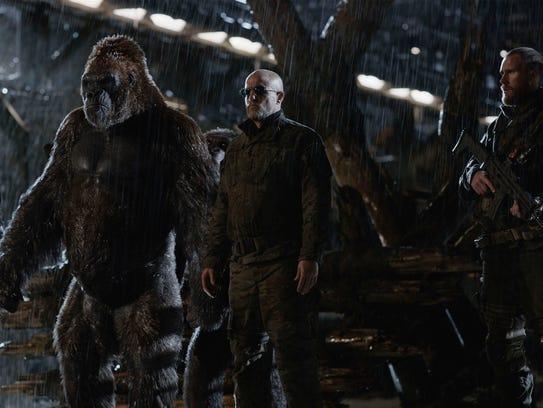 The villainous Colonel (Woody Harrelson, center) has