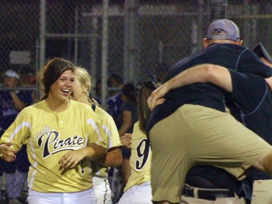 Kaplan celebrates its state softball championship Saturday night.