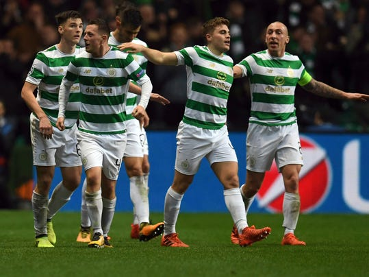 Celtic's Callum McGregor, second left, celebrates scoring during the Champions League group B match between Celtic FC and FC Bayern Munich at Celtic Park, Glasgow, Tuesday Oct. 31, 2017. (AP Photo)