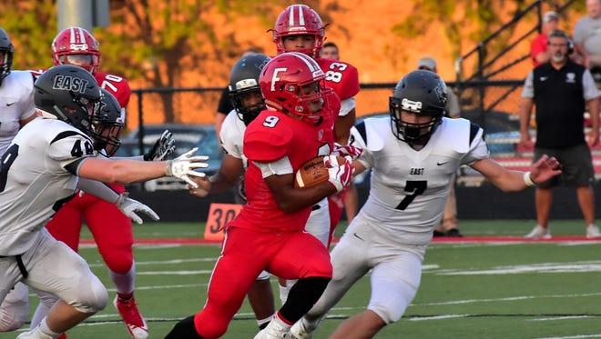 Juthan McClain (9) breaks through the Lakota East defense for a Fairfield touchdown Sept. 15.