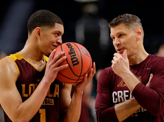 Loyola-Chicago head coach Porter Moser talks to Lucas Williamson (1) during a practice session for the Final Four NCAA college basketball tournament, Friday, March 30, 2018, in San Antonio. (AP Photo/Eric Gay)