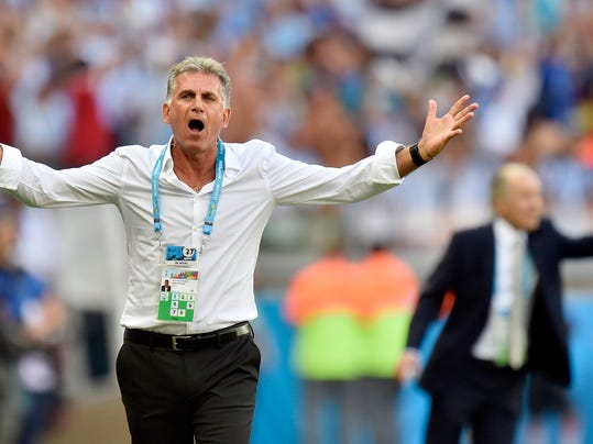 Iran's head coach Carlos Queiroz questions a call during the group F World Cup soccer match between Argentina and Iran at the Mineirao Stadium in Belo Horizonte, Brazil, Saturday, June 21, 2014. Argentina defeated Iran 1-0. (AP Photo/Martin Meissner)