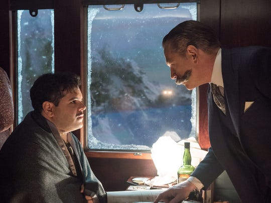 Personal assistant Hector MacQueen (Josh Gad, left) is questioned by super-sleuth Hercule Poirot (Kenneth Branagh) in the Agatha Christie mystery adaptation 'Murder on the Orient Express.'