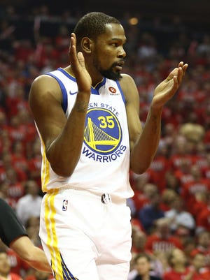Kevin Durant reacts during the first quarter of Game 1 against the Rockets.