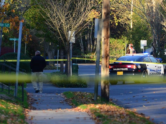 Salem Police closed several roads near state buildings downtown after they found Michael Hampshire's body on Wednesday, Nov. 12, 2014.
