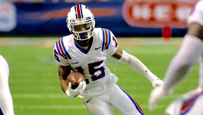 Louisiana Tech cornerback Bryson Abraham returns an interception 25 yards for a touchdown in the Bulldogs' win Saturday over UTSA.