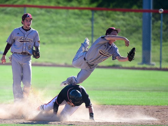 Ankeny shortstop Drew Hill (15) makes a throw to first after tagging Valley's Jake Griffiths (15) out at second on Wednesday, June 15, 2016, during a baseball game between Ankeny and Valley at Valley High School.
