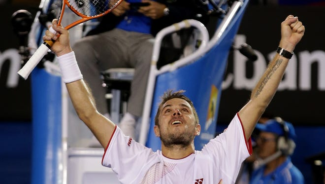 Stanislas Wawrinka celebrates after defeating Rafael Nadal to win his first career Grand Slam championship.