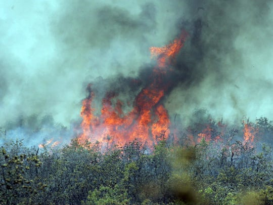 051607 - POCEAN - Fire burning at mid-day on the Warren Grove Range -
