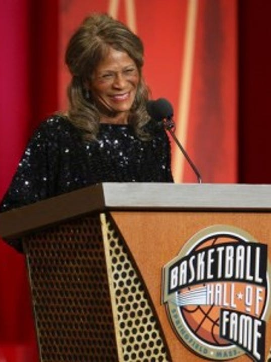 C. Vivian Stringer, the first coach to lead three different teams to the Final Four, laughs during her induction speech into the Naismith Memorial Hall of Fame. (AP Photo)