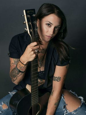 """Aster Pheonyx is the voice of the John Ginty Band on the single """"Lucky 13."""""""