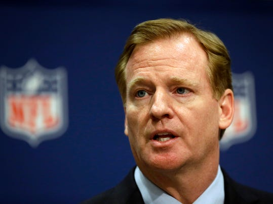 FILE - In this May 20, 2014, file photo, NFL Commissioner Roger Goodell speaks at a press conference at the NFL's spring meeting in Atlanta. Steve Silverman, the lead plaintiffs' attorney, said this week, dozens of former players are joining a lawsuit against the NFL saying teams kept handing out powerful painkillers and other drugs with few, if any, safeguards as recently as 2012 to keep players on the field. That extends by four years the time frame for similar claims made by hundreds of former players in the original complaint and could open the door to a criminal investigation.  (AP Photo/David Goldman, File)