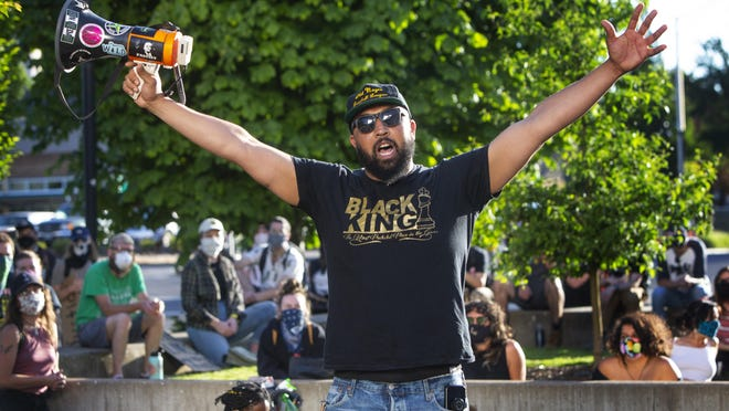 Isiah Wagoner speaks to fellow protesters at the Federal Courthouse during a Black Lives Matter demonstration in Eugene, Ore. Wednesday, June 3, 2020. [Chris Pietsch/The Register-Guard file] - registerguard.com