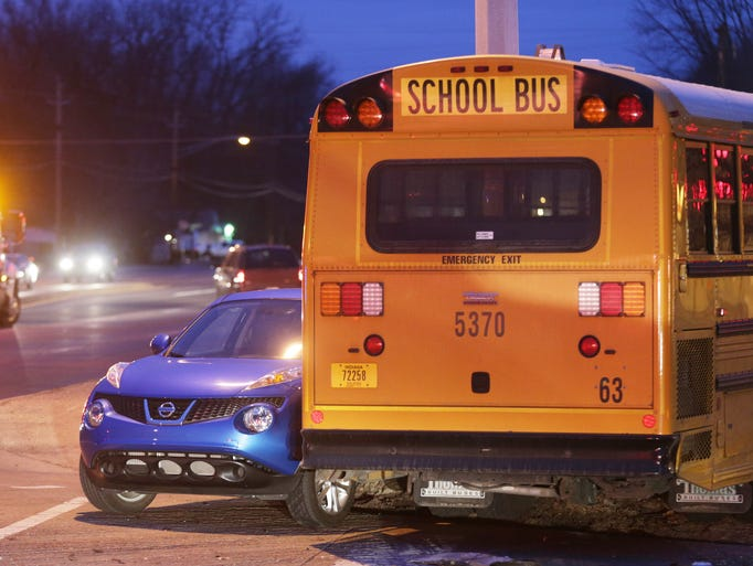 Scene of a crash involving three passenger vehicles and a school bus containing no children, at the corner of 65th and Keystone Ave, Monday, March 17, 2014.