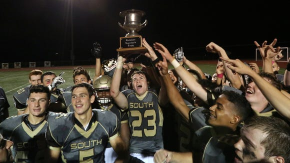 Clarkstown South players celebrate with the Supervisor's