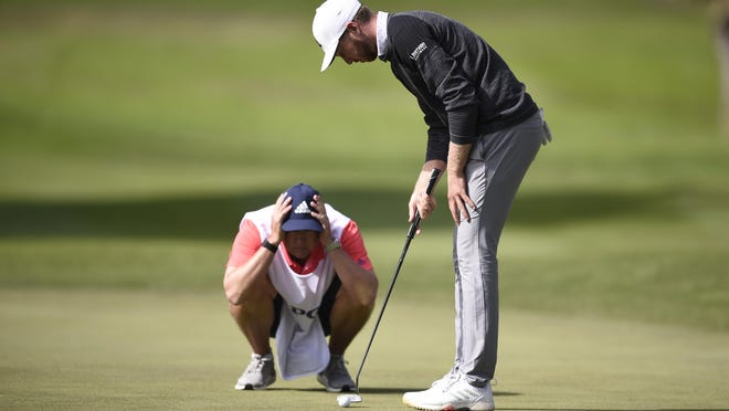 Daniel Berger (front) and his caddie, Josh Cassel, line up a putt  on the 12th green during the second round of the PGA Championship at TPC Harding Park.
