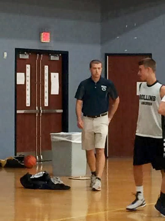 A Chambersburg native, Scott Barrows, center, will take over as the new coach of the Camp Hill High School boys varsity basketball team. His hiring was approved by the school board on Monday.