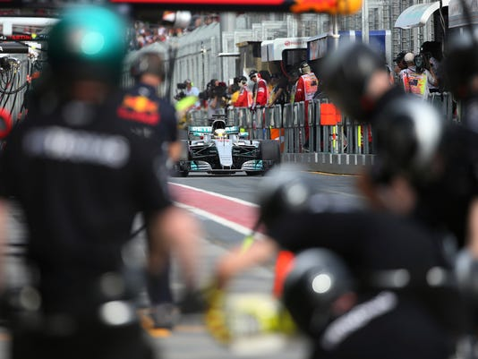 Mercedes driver Lewis Hamilton of Britain steers his car towards his pit lane garage during the second practice session for the Australian Grand Prix in Melbourne, Australia, Friday, March 24, 2017. (AP Photo/Rick Rycroft)