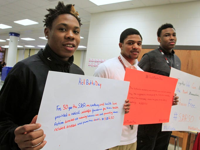 Students Tre Turentine, from left, Christian Jones, and Joshua Price hold tobacco-free signs at Shortridge High School, Wednesday, March 19, 2014.  As part of the national Campaign for Tobacco-Free Kids, Shortridge joined the national Kick Butts Day by encouraging students to sign a pledge saying they won't smoke.  The event hopes to educate youth about tobacco and its harmful effects.