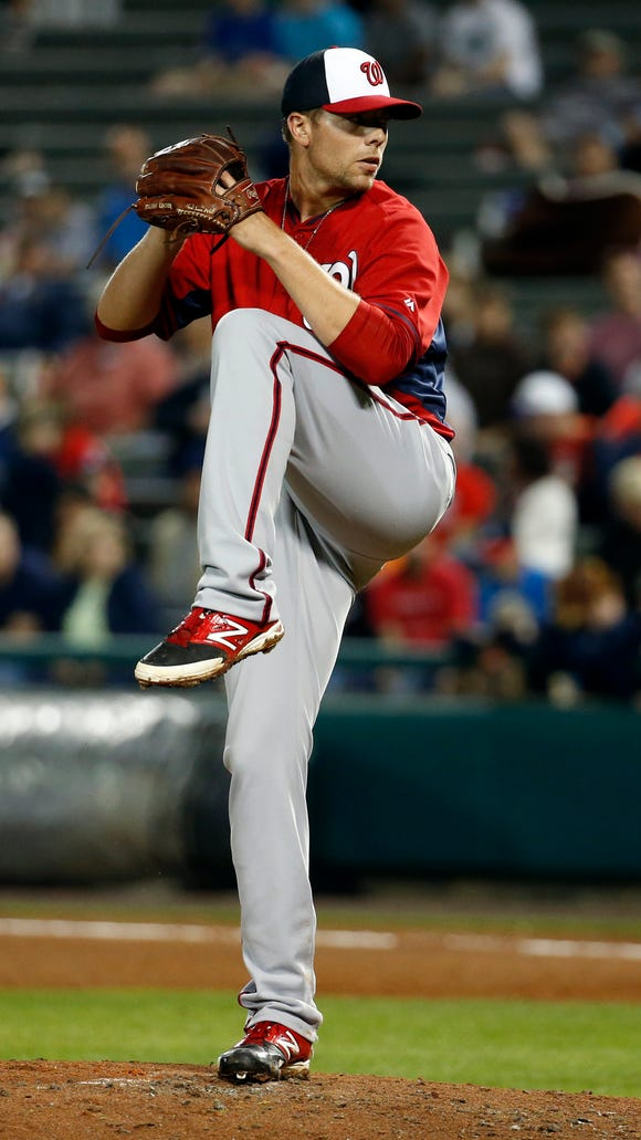 Washington Nationals relief pitcher Blake Treinen (64) throws in a spring exhibition baseball game against the Atlanta Braves, Thursday, March 6, 2014, in Kissimmee, Fla. The Braves won 3-2. (AP Photo/Alex Brandon)