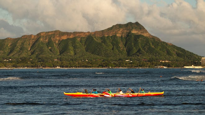 A outrigger canoe paddles past Diamond Head, Wed. Sept. 16, 2015 in Honolulu.
