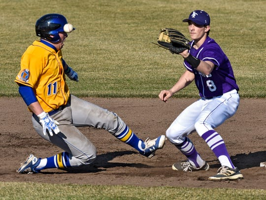Jacob Kapphahn of Little Falls tries to tag Cathedral's