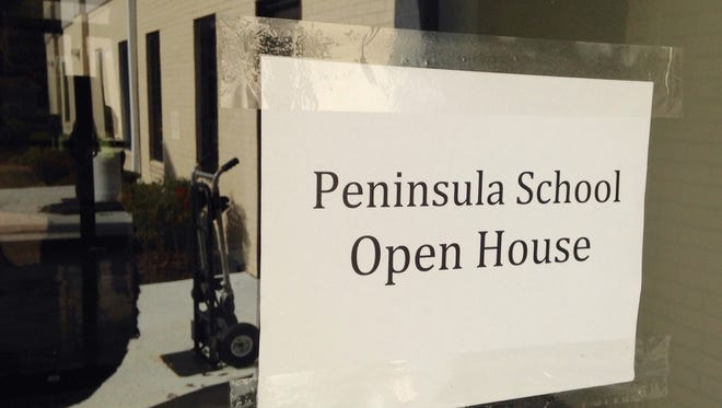 A sign on a door at 424 Phillip Morris Drive in Salisbury welcomes stakeholders to an open house for a proposed high school, the Peninsula School for grades nine through 12. Organizers have a September 2017 opening date for the ninth grade. Other grades would be added in phases, organizers say.