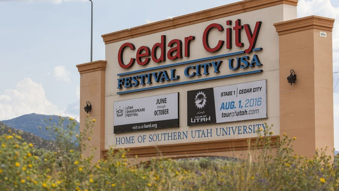 A Cedar City sign sits along Interstate 15 at the north end of town.