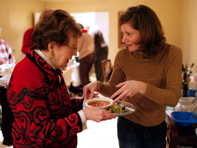 """Dottie Frank, left, is served soup by Jennifer Schultz before guest artist Harry Pickens, an American jazz pianist, performs for those in attendance at the annual Bonnycastle Homestead Association Soup and Salad Event. Held at the Park Terrace Condominiums, the event focused on """"Community Transformation ... in the Key of Jazz!"""" with an inspirational discussion led by Pickens.  January 26, 2014"""
