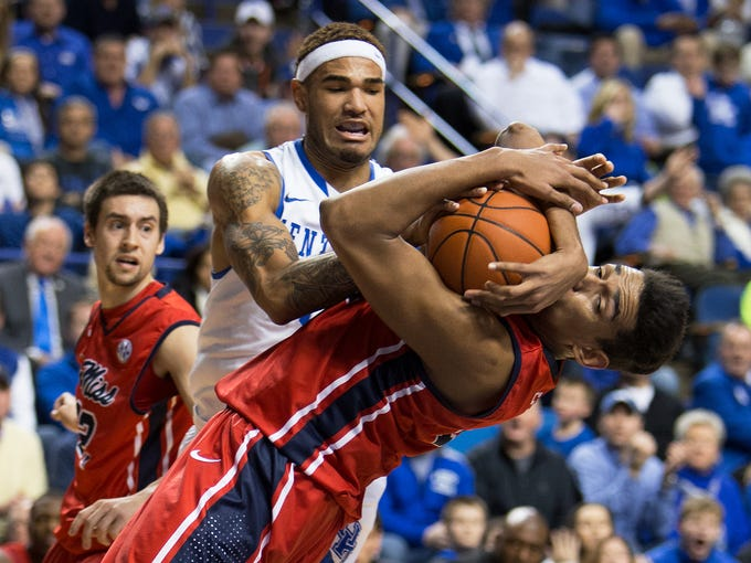 UK forward Willie Cauley-Stein, center, fights for a loose ball with Ole Miss forward Sebastian Saiz, right, in the first half. The University of Kentucky hosted Ole Miss, Tuesday, Feb. 04, 2014 at Rupp Arena in Lexington. Photo by Jonathan Palmer/Special to the Courier-Journal