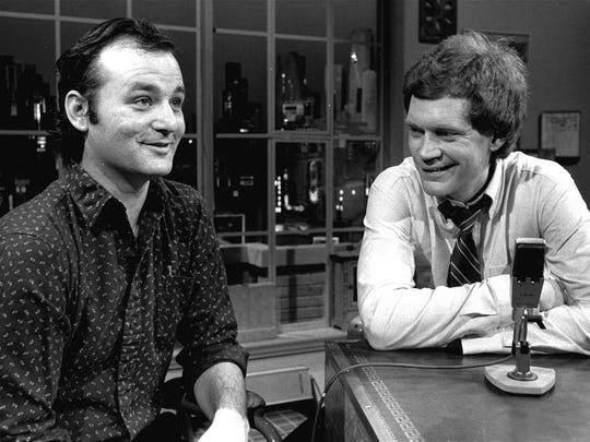 """Nancy Kaye/AP Guest Bill Murray appears with host David Letterman at the Feb. 1, 1982, taping of the debut of """"Late Night with David Letterman"""" in New York. FILE - In this Feb. 1, 1982 file photo, host David Letterman, right, and guest Bill Murray appear at the taping of the debut of """"Late Night with David Letterman"""" in New York. After 33 years in late night and 22 years hosting CBS' """"Late Show,"""" Letterman will retire on May 20. (AP Photo/Nancy Kaye, File)"""