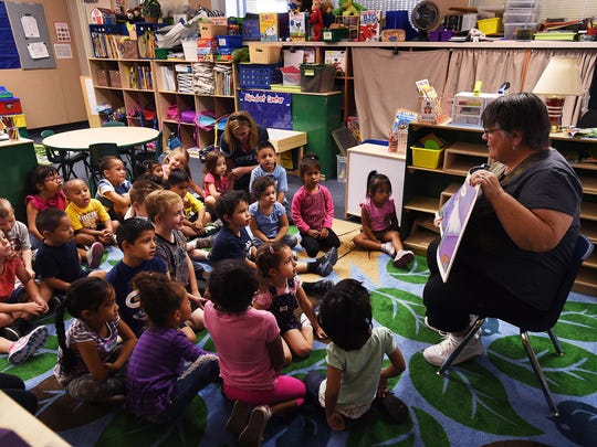 Teacher Lory Rehne, right, gathers her pre-kindergarten class for story time at Booth Elementary School in Reno on Aug. 27.