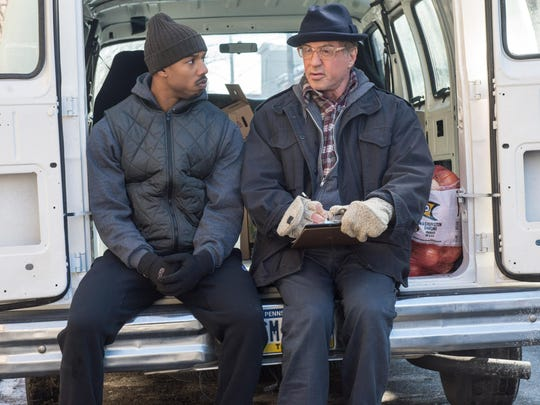 """This photo provided by Warner Bros. Pictures shows Michael B. Jordan, left, as Adonis Johnson and Sylvester Stallone as Rocky Balboa in Metro-Goldwyn-Mayer Pictures', Warner Bros. Pictures' and New Line Cinema's drama """"Creed,"""" a Warner Bros. Pictures release."""