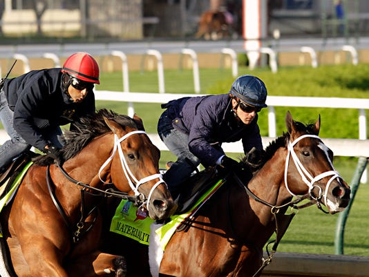 FILE - In this April 24, 2015, file photo, jockey Javier Castellano, right, gets Kentucky Derby hopeful Materiality in front of stablemate Itsaknockout, left, with exercise rider Ezequiel Perez, during a morning workout at Churchill Downs in Louisville, Ky. Castellano has won the last four Eclipse Awards as the best jockey in racing, but has never won a Kentucky Derby in 10 career chances. He hopes that changes this year when he rides Gunnevera in the Run for the Roses. (AP Photo/Garry Jones, File)