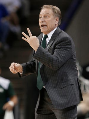 Michigan State basketball coach Tom Izzo directs his team against Virginia in Charlotte, N.C., on Sunday, March 22, 2015.