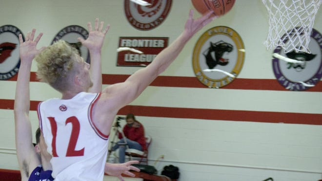 Ottawa High School junior Noah McCullough takes the ball to the hole Friday during a loss to Piper at the OHS gym.