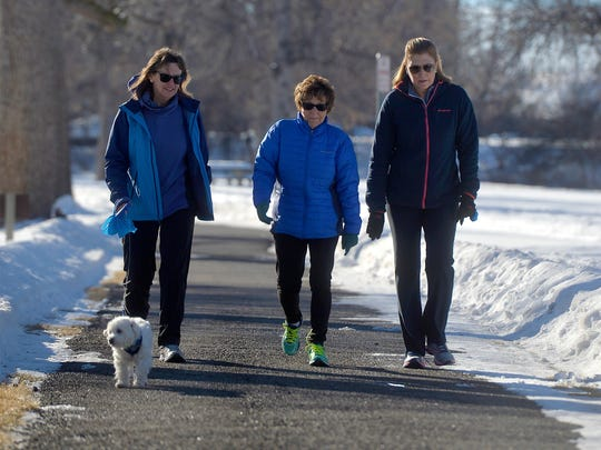 Diana Leonard, left, and her dog Chewy walk with Barb
