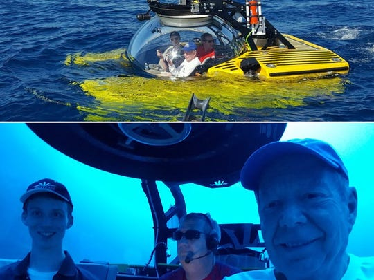 John Mills (below right) with his grandson, Johnny Vincent (left), join Triton submarine pilot Troy Engen on a deep dive off the Bahamas in this 2017 photo.