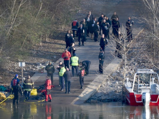 Emergency personnel at the scene where a Metro Nashville Police officer went missing during a water rescue in the Cumberland River Thursday, Feb. 2, 2017 in Madison, Tenn.