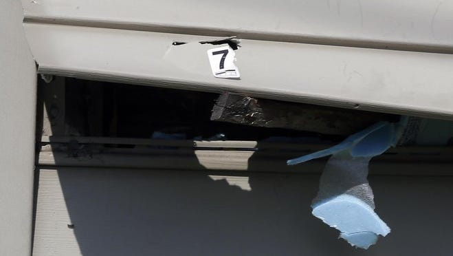 A bullet hole is marked as evidence on the exterior of a home in the 1500 block W. Meineke Ave., where a 9-year-old girl was struck by a stray bullet while watching television as a gun battle raged outside her home. Za'layia Jenkins was pronounced dead at 5 p.m., according to a medical examiner's official.