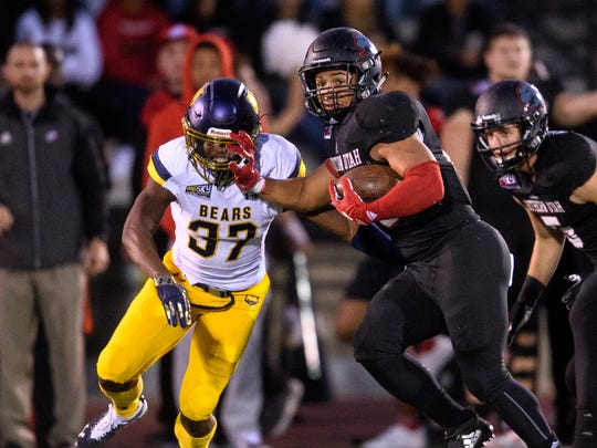 Southern Utah University running back Karris Davis (26) stiff-arms a University of Northern Colorado defender at SUU Saturday, October 27, 2018.