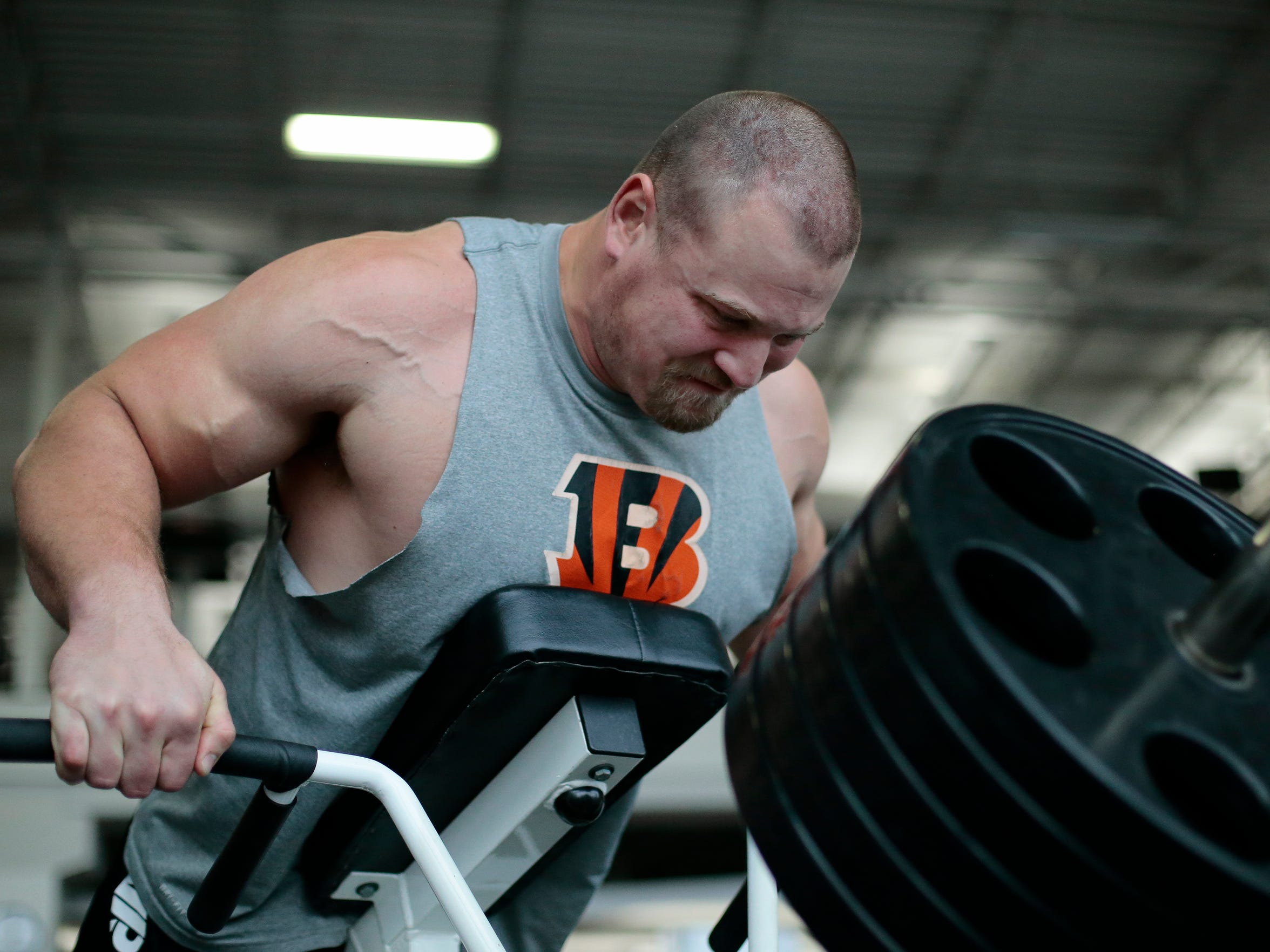 """Cincinnati Bengals right guard Kevin Zeitler lifts through an upper body workout at the Princeton Club in New Berlin, Wis., on Wednesday, April 13, 2016. At 6' 4"""" tall and 315 pounds, Zeitler prides himself on the lean body mass he's achieved ahead of official team actives in Cincinnati."""
