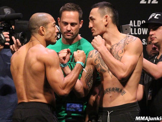 636321140173569124-jose-aldo-max-holloway-ufc-212-ceremonial-weigh-ins.jpg