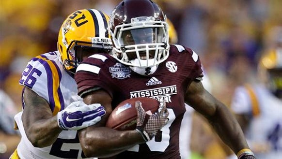 Mississippi State running back Josh Robinson (13) carries