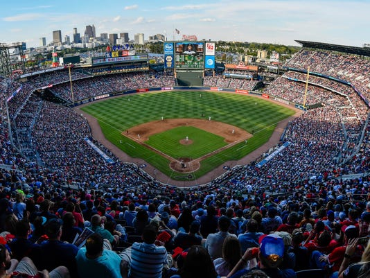 FILE - At left, in a May 18, 1996, file photo, Centennial Olympic Stadium is shown during Grand Opening ceremonies in Atlanta. At center, in an Oct. 2, 2016, file photo, fans watch the final baseball game at Turner Field, between the Atlanta Braves and the Detroit Tigers, in Atlanta. At right, in an Aug. 17, 2017, file photo, Georgia State Stadium is shown in Atlanta. From Olympic track and field to major league baseball to, now, college football, this place has undergone plenty of changes since it broke ground less than a quarter-century ago. (AP Photo/File)