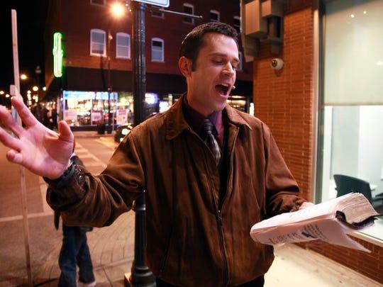 Street preacher Aaron Brummitt giving a sermon down