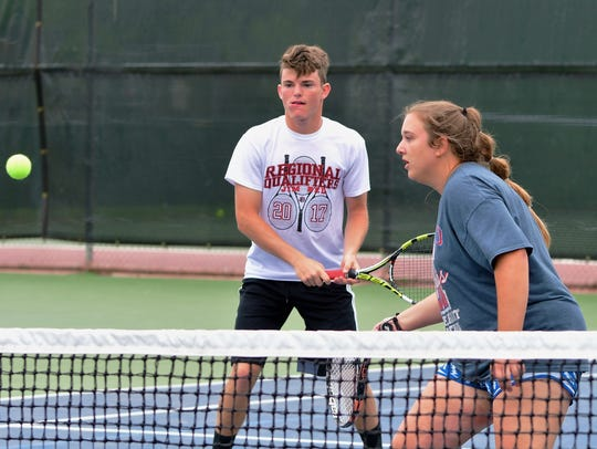The Jim Ned mixed doubles combo of Jackson Hanna and Paige Abercrombie converge on a shot during the Region I-3A tournament at Rose Park Tennis Center on April, 20 in Abilene.