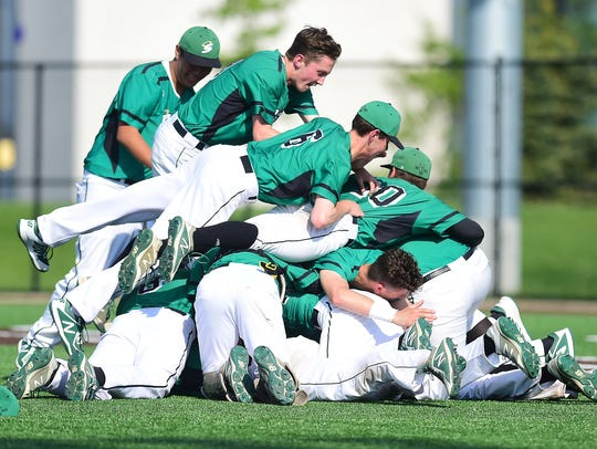 Seton Catholic Central players celebrate after their 10-0 victory over Oneonta in the Section 4 Class B final Friday at Binghamton University.