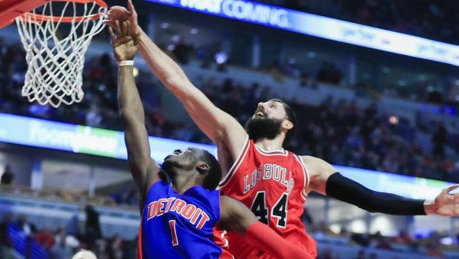 Pistons guard Reggie Jackson shoots on Bulls forward Nikola Mirotic in the first half at the United Center in Chicago on March 22, 2017.
